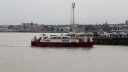 Gravesend to Tilbury passenger ferry arriving at Tilbury Essex UK Footage