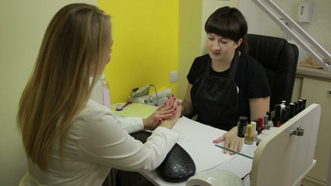 Happy woman getting her nails done at beauty salon Footage