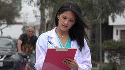 Female Doctor Or Nurse Writing Footage