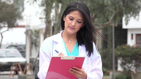 Female Nurse Or Doctor Writing Live-Action
