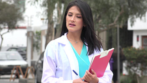 Female Doctor Or Nurse Smiles Live Action
