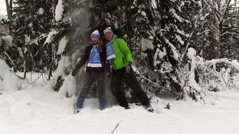 Funny young couple play in the winter forest Footage
