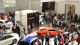 car exhibition - parked cars and people walking and watching cars - interior - t Footage