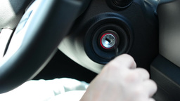 Woman (hand) Start Up Car - Close Up stock footage