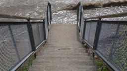 Steps down to a dirty river Tilbury Essex UK ビデオ