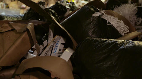 Large warehouse of waste paper in a factory ビデオ