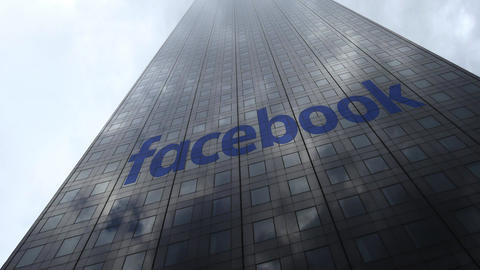 Facebook logo on a skyscraper facade reflecting clouds, time lapse. Editorial 3D Live Action