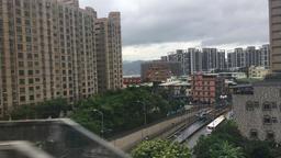 Taipei suburb cityscape Taipei Taiwan from High Speed Train Footage