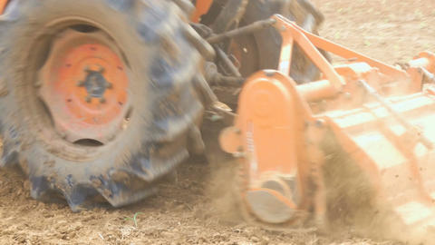 4K Tractor is tracking on dry country earth ground preparing for planting Footage