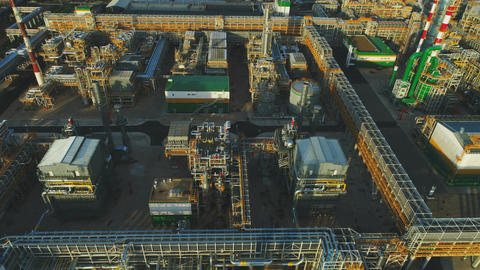 Drone Flies over Plant Territory with Departments Oil Tanks Footage