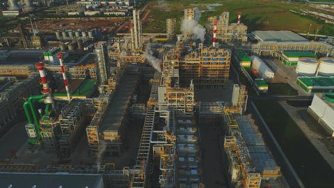 Aerial View Buildings Smoking Chimneys on Refinery Territory Footage