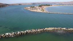 Aerial Sideways Pan Of A Coastal Rock Jetty Footage