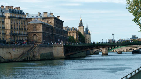 Steadicam walk along the Seine river embankment and old buildings in Paris Footage