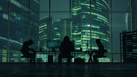 Hackers at work on the background of green office buildings Animación