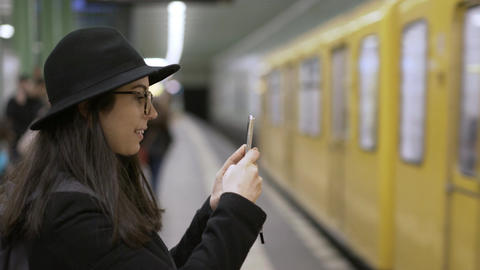 Woman filming the Subway arriving a Station in Berlin Footage