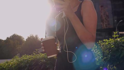 Female holding smartphone use app 画像