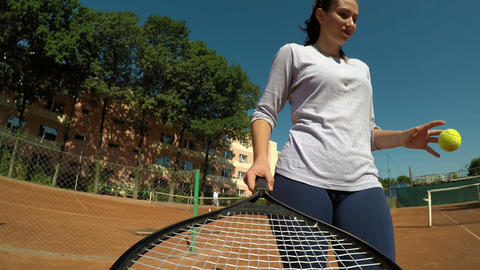 POV point of view of woman holding tennis racket in hand on tennis court serving Footage