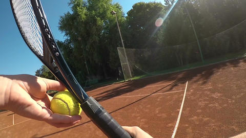 Slow motion POV woman serving and playing tennis match Footage
