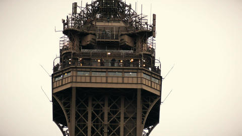 Observation deck on the top of the Eiffel tower in Paris, France. Telephoto lens Footage