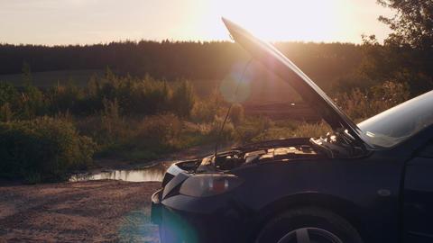 Female looking on engine at sunset Footage