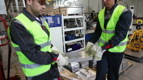 Workers taking aluminium billet Footage