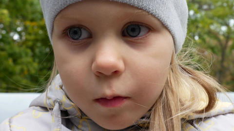 Little Beautiful Blonde Girl With Blond Hair And Blue Eyes Eats Chocolate Footage