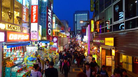 Takeshita Street in Harajuku Tokyo Japan at dusk ビデオ