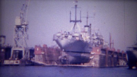1956: Dry docked container cargo ship repairs made in harbor Footage