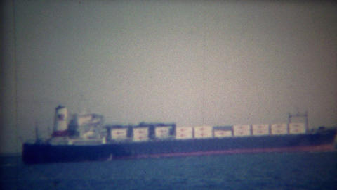 1956: Full cargo container ship heading out to open ocean water Footage