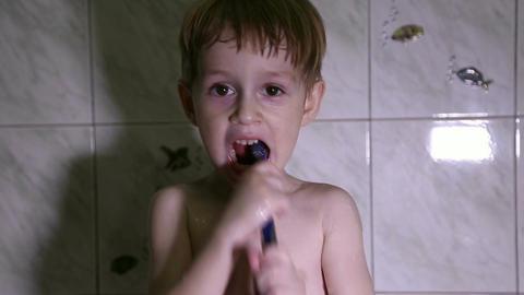 Little boy brushing his teeth Footage