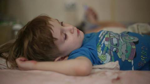 Little boy falls asleep Live Action