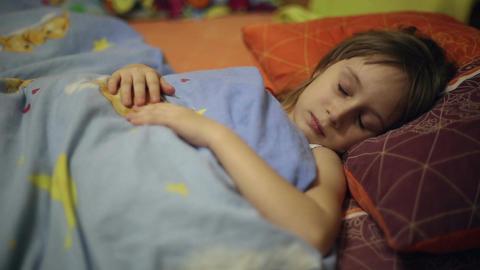 Little girl falls asleep, she yawns Live Action