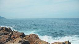 Serene Blue Sea Waters, Waves Breaking Into Rocks Footage