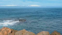 Serene Blue Sea, Waves Breaking Into Rocks Footage