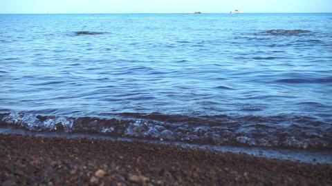 Sea waves roll on the pebble beach Footage