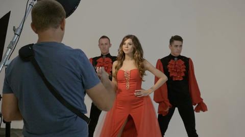 The photographer shoots artists in red suits Footage