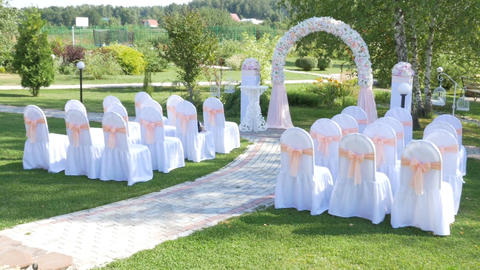 Decorated rows of chairs at the wedding ceremony Filmmaterial
