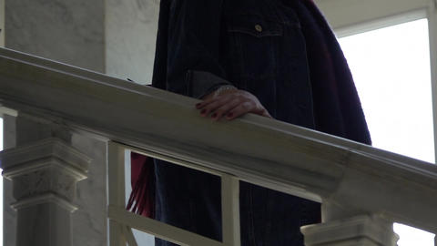 Closeup of Hand Moving Along Banister Footage
