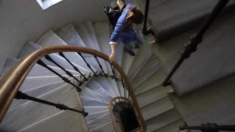 Woman Descends Ornate Marble Staircase Footage