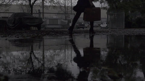 Woman Walks Near Puddle Footage