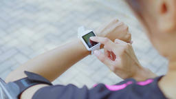 Woman use of smart watch and cellphone Footage