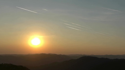 Timelapse with airplanes that cross the sky in the early morning, in front of th Footage