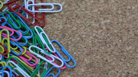 Colorful Paper Clip Clasp Office Stuff Slide on a Cork... Stock Video Footage