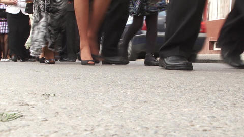 Column Of People Marching In A Concrete Way, Following The Two Grooms Who Are He stock footage