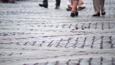 Foot by men which is a walk in the central square of a city paved with stone 23 Footage