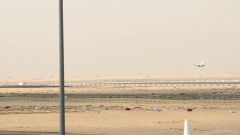 Small batteplane fly down to runway, landing at Al Maktoum airport Live Action