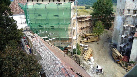 Construction Site Of A Historic Building. Workers Working On Restoring Old Walls stock footage