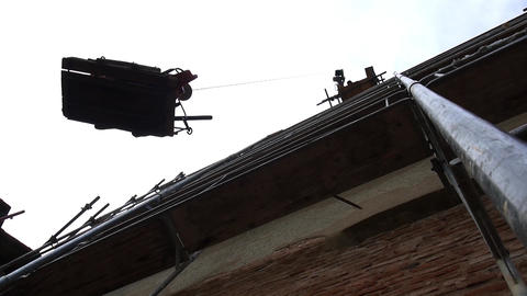 Crane installed on a metal scaffold down a metal platform with needful materials Footage