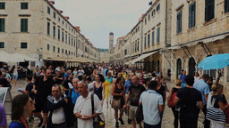 People walking on the central square of Dubrovnik right after rain in Autumn sun Footage