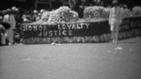 1945: Honor Loyalty Justice WW2 victory flower covered parade float Footage